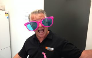 Business manager Peter in oversized pink glasses