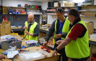 Peter Lind instructing at the work bench